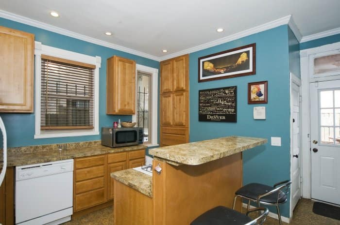 can lighting in blue kitchen