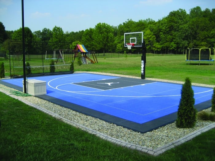 Blue basketball court with Michael Jordan logo - Know The Cost To Get Your Dream Basketball Court Installed Angie's
