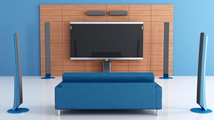 blue couch with surround sound and smart TV