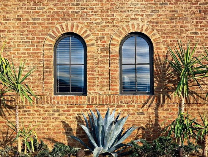 brick wall with windows