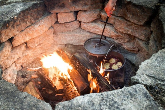 cooking a cobbler on campfire