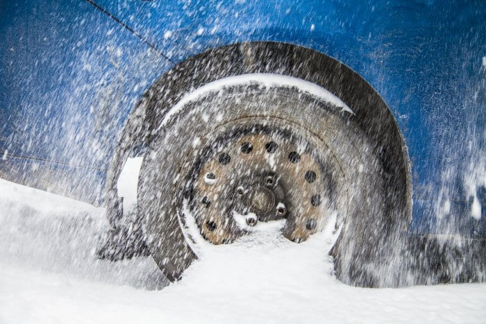 a car wheel spinning in snow