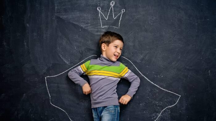 kid in front of chalkboard wall