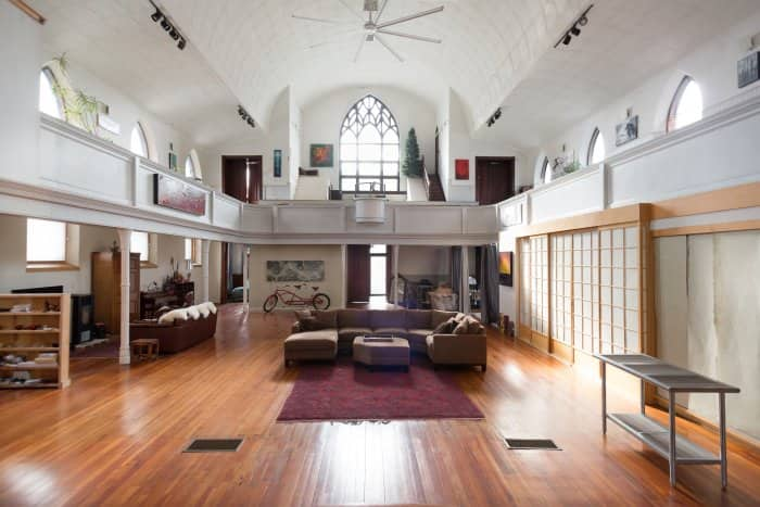 church hall converted into living room with couches