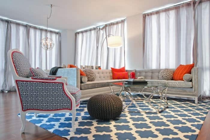 living room with patterned furniture and rug