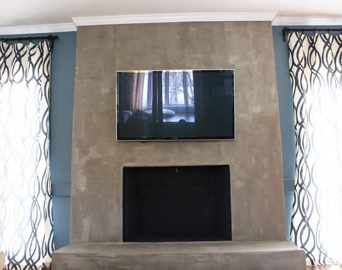 Concrete Fireplace Mounted Tv