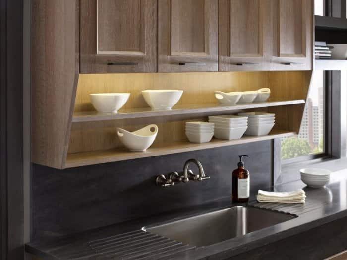 Utilizing previous unused space is one way to get creative with kitchen cabinet storage, such as this over-the-sink open shelving unit. (Photo courtesy of DuPont)