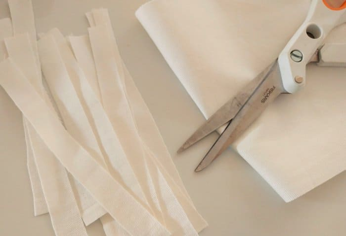 cutting white fabric strips