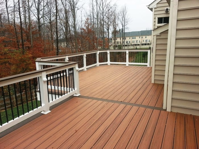 deck with white railing and metal spindles