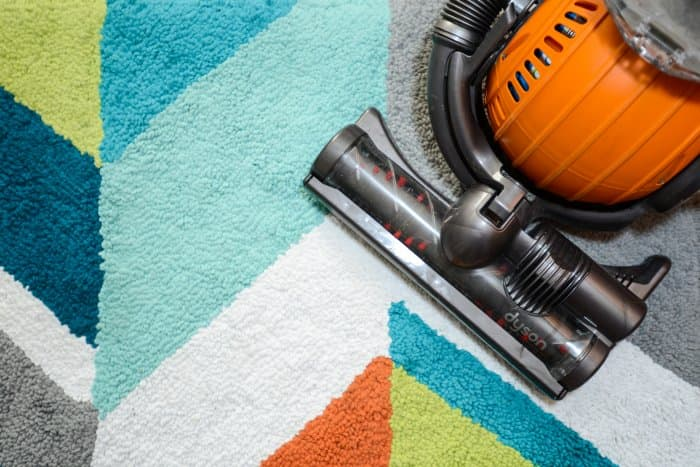 dyson vacuum on colorblocked rug (Photo by Summer Galyan)