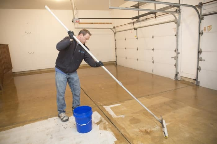 Epoxy coating transforms boring flooring angie39s list for How to install epoxy garage floor