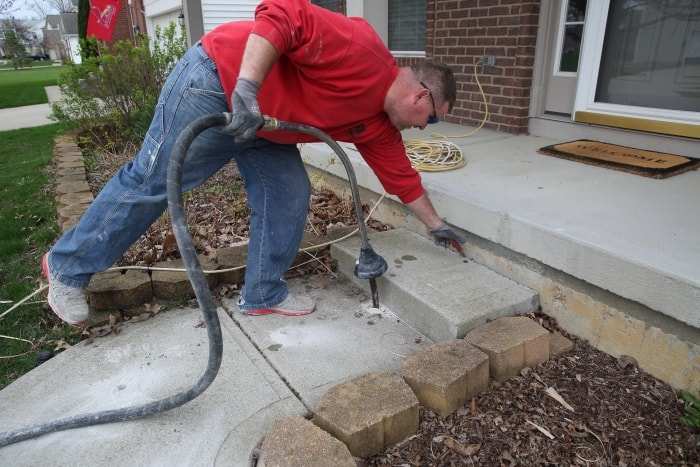 Josh Truax Of A 1 Concrete Leveling U0026 Foundation Repair Injects Liquified  Limestone While Repairing A Sidewalk In Fishers, Indiana.