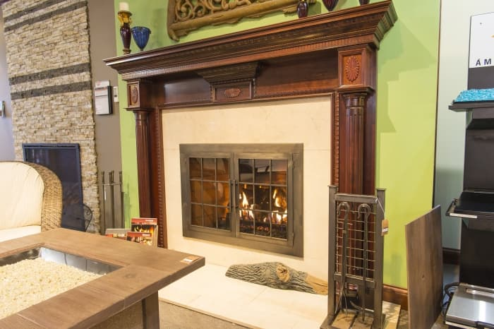 Gas Fireplace With Wood Surround And Glass Doors