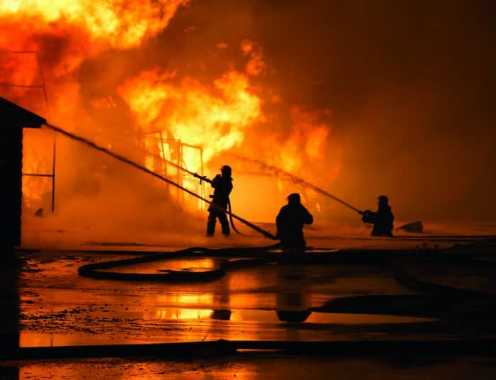 Firefighters battling blaze with hoses