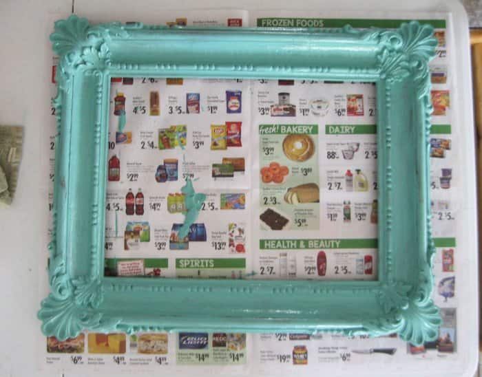 ornate frame with base coat of a teal paint