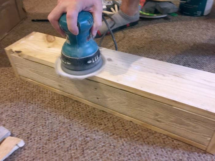 sanding DIY floating shelf