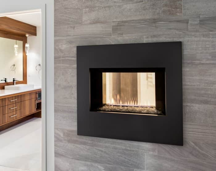 Double-sided glass fireplace used as room divider