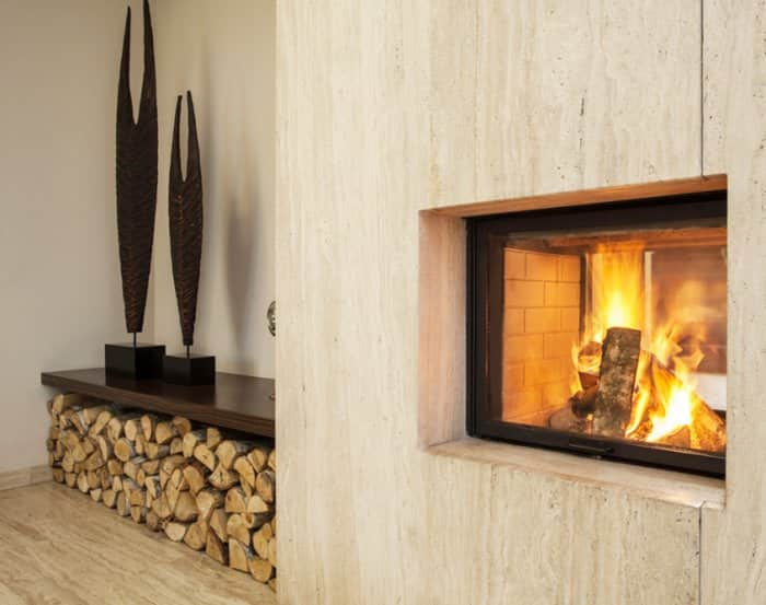 Wood-burning fireplace with wood stored on side