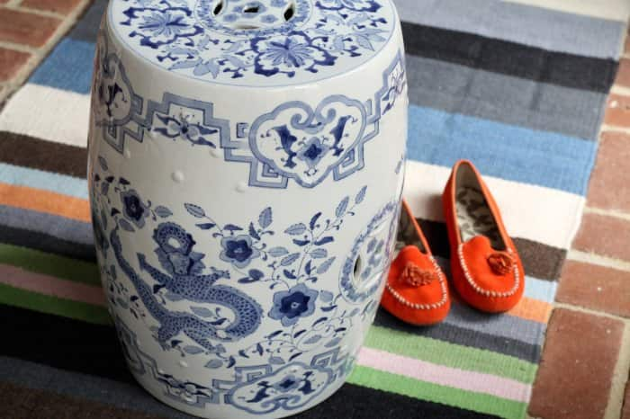 ceramic garden stool on colorful rug