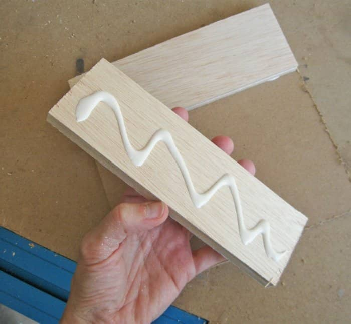 hand holding wood with glue