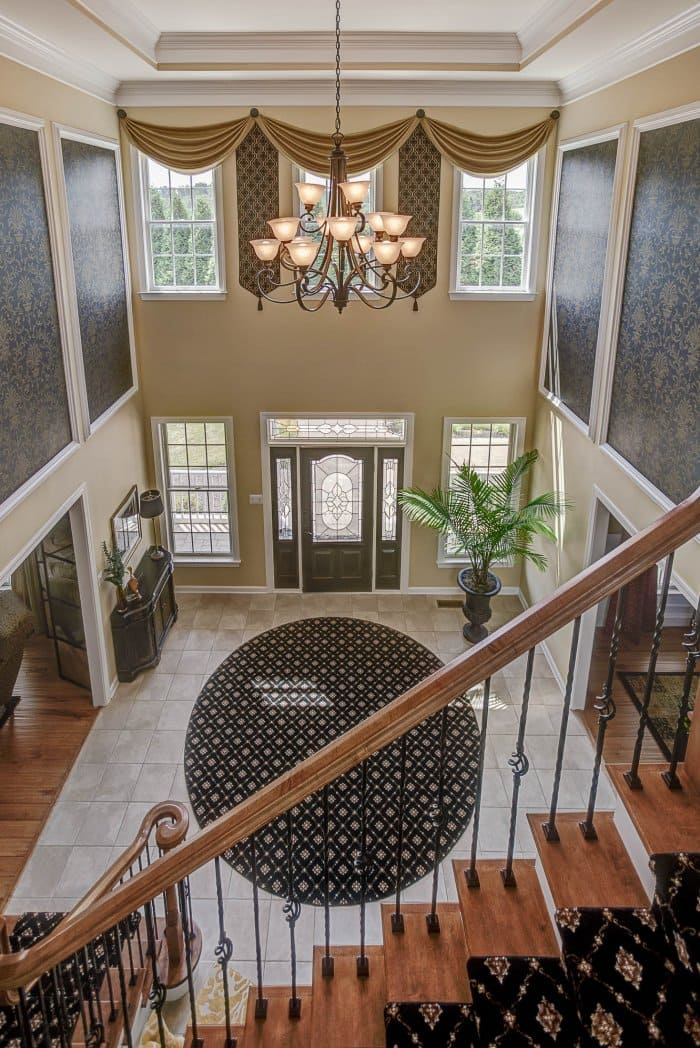 interior stair railing designs ideas and decors most.htm how to decorate a grand entrance angie s list  how to decorate a grand entrance