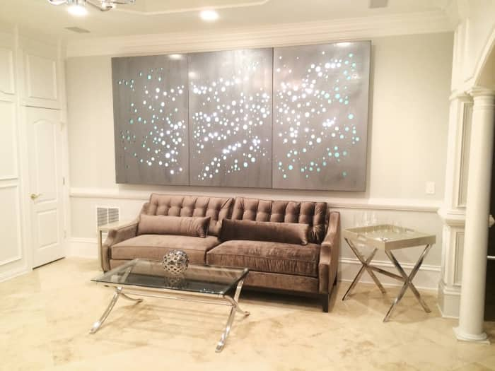 remodeled basement with wall art