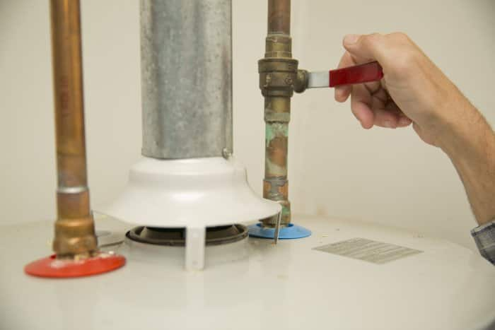 Turn off cold water to water heater.