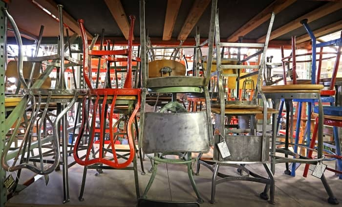 metal chairs at a salvage shop