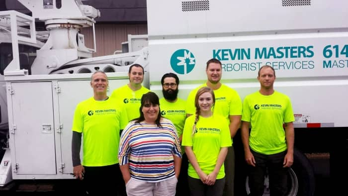 crew of Kevin Masters Arborists Service in front of truck