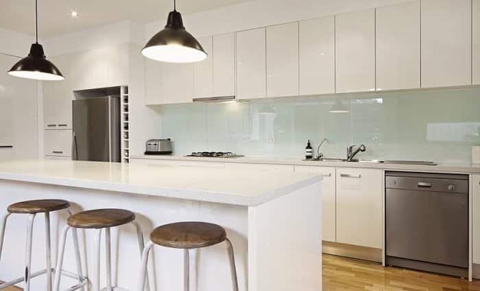 white kitchen with task lighting and pendant lighting
