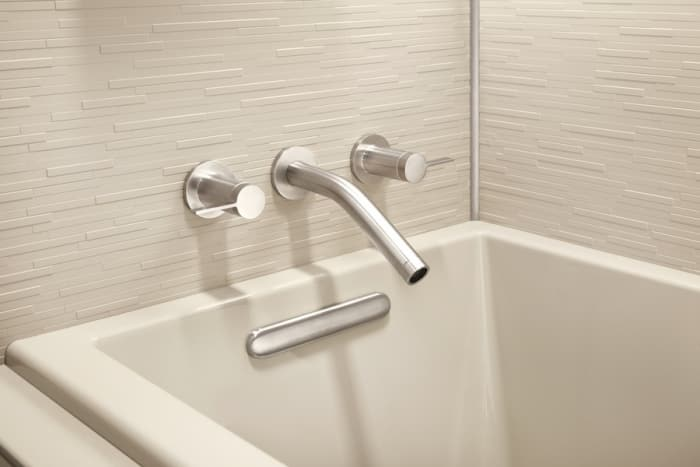 Clean Bathtub With Modern Spout And Tile