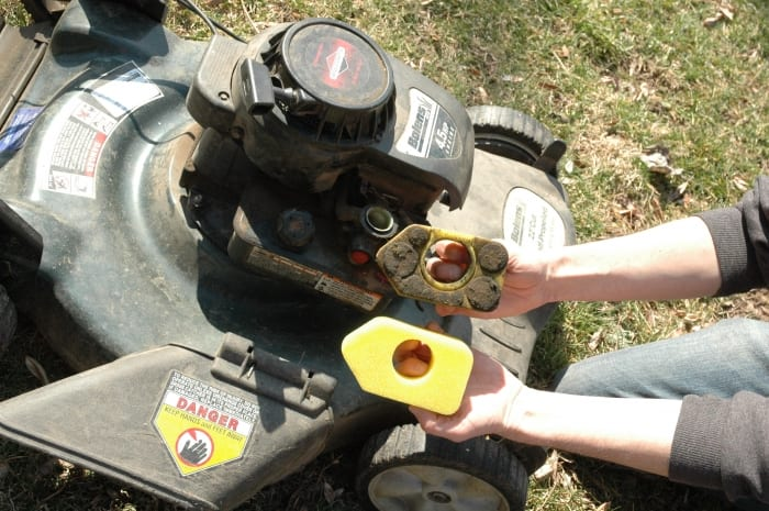 Changing the air filter on a lawn mower