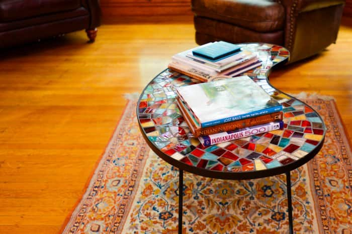 wood flooring and coffee table on rug