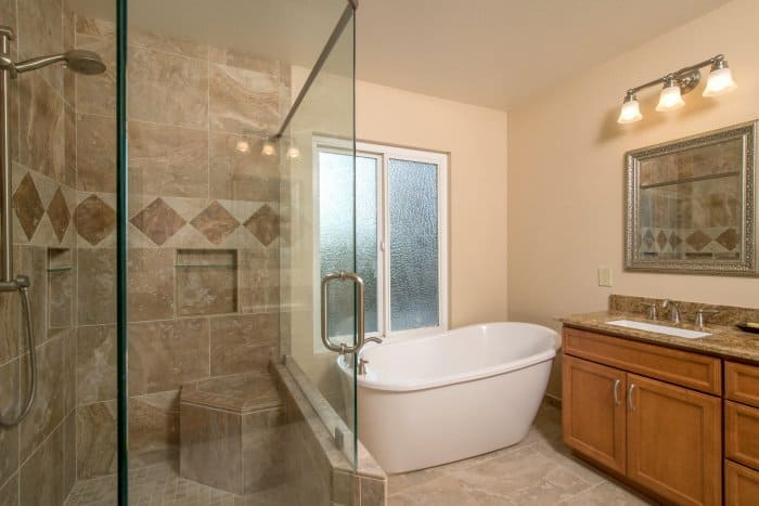 master bathroom with walk-in shower, garden tub