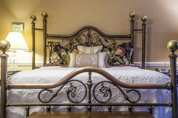 Bed with wrought iron head board