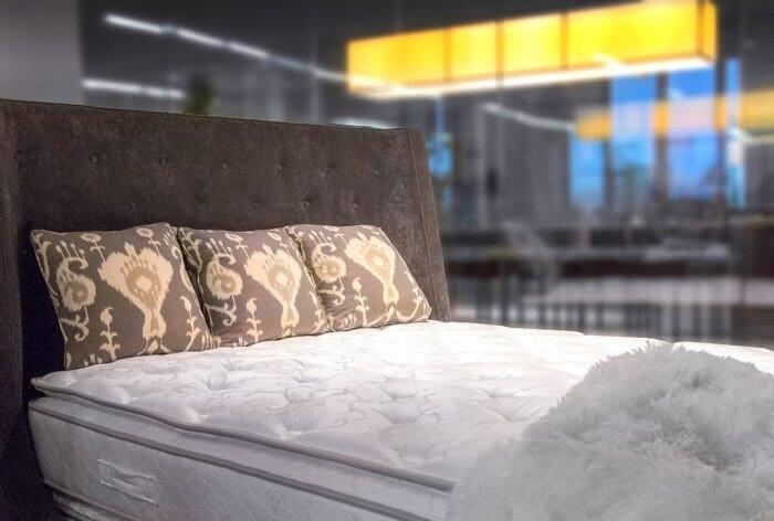 A mattress with pillows