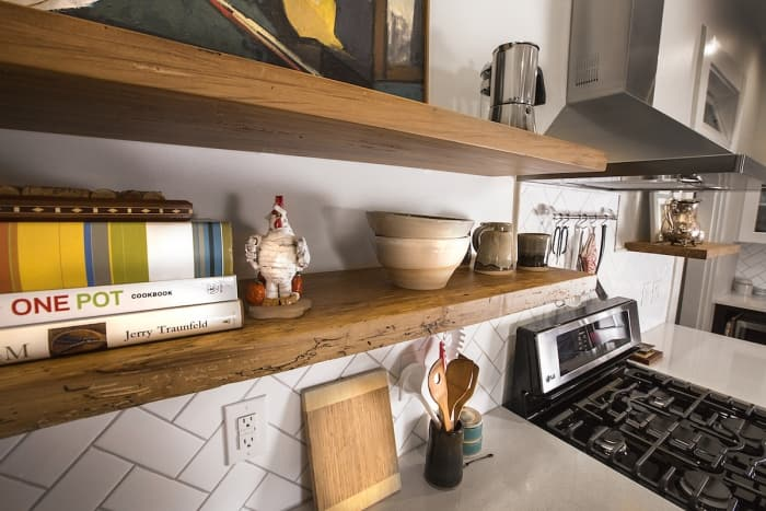 floating shelves and stove with hood