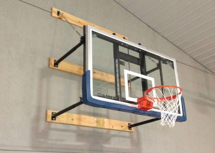 Wall Mounted Basketball Goal In Gymnasium