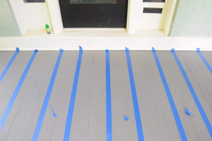 adding painters' tape to porch