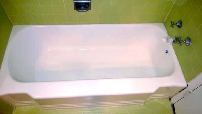 Refinished 1949 bathtub with green tile splash and floot