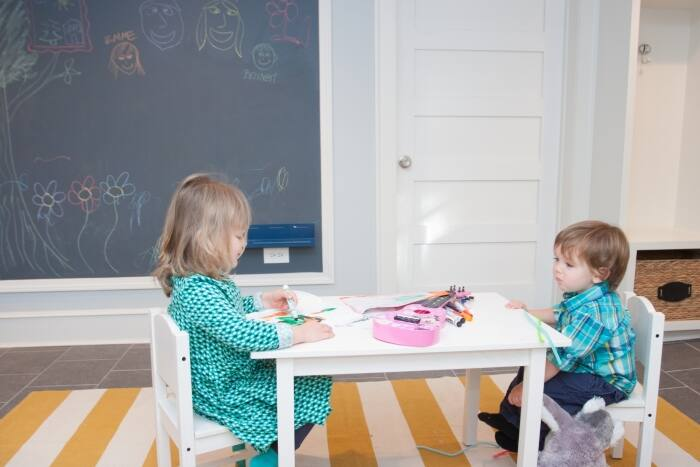 kids playing in remodeled basement with chalkboard