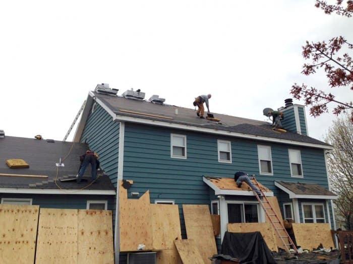 Roofers Installing A New Roof On House