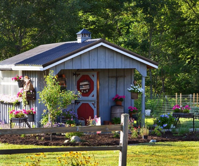 rustic garden shed with country accessories and flowers by the olde weeping cedar - She Shed