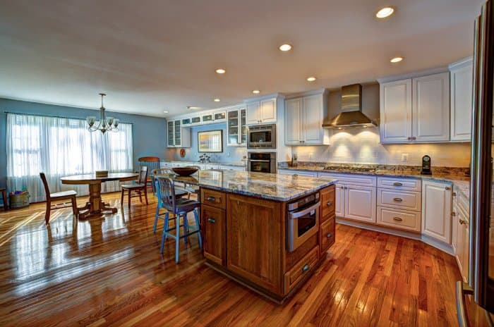Large Kitchen With Island Table Wood Flooring