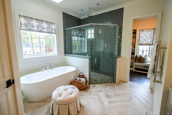 Spa Like Bathroom With Seating And Large Tub