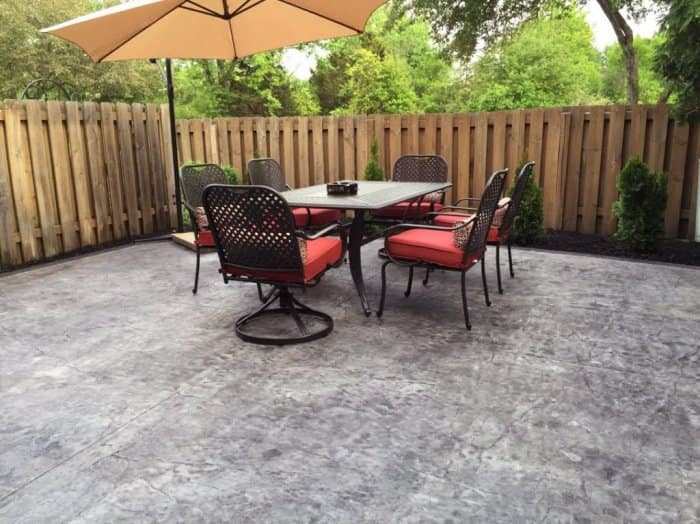 A table and chair set on stamped concrete. The new stamped concrete patio  installation ... - 7 Tips To Hire The Best Stamped Concrete Contractor Angie's List