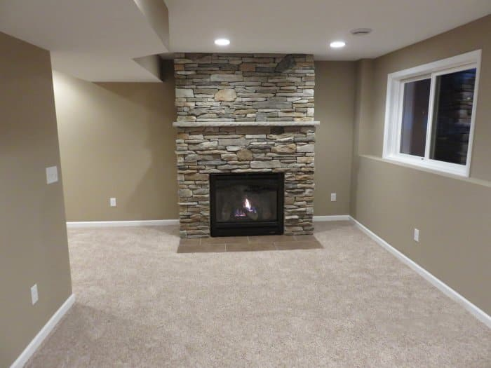 fireplace with floor-to-ceiling stonework