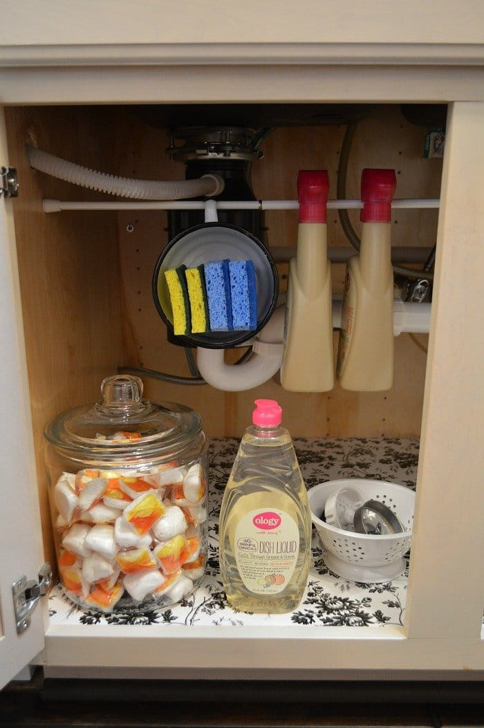 tension rod organization under kitchen sink