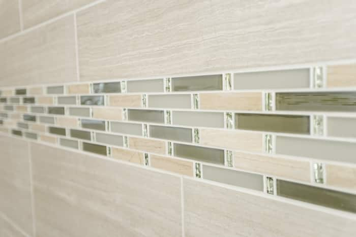tile mosaic in subway tile shower