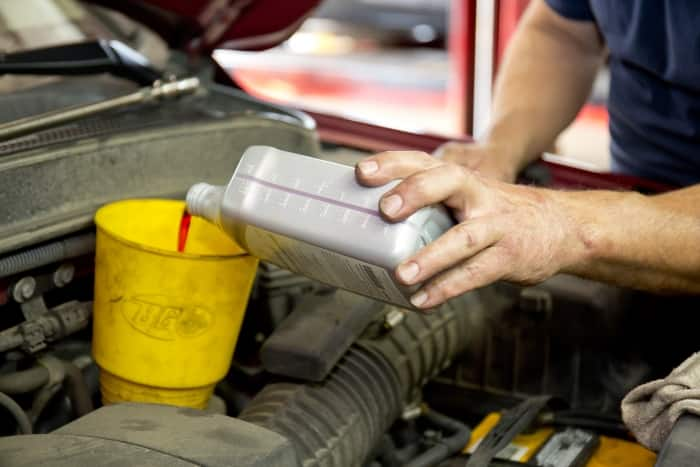 Mechanic changing transmission fluid